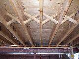 Main floor construction with cross bridging joist hangers for Wood floor joist bridging
